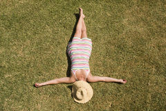 Woman laying in the grass Royalty Free Stock Images