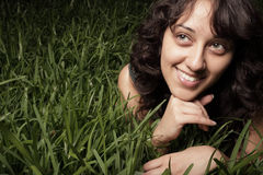 Woman laying on the grass Stock Photography