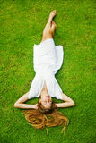 Woman laying on a grass Royalty Free Stock Images