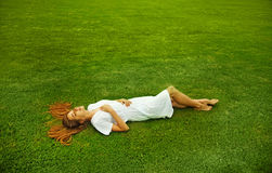 Woman laying on a grass Royalty Free Stock Photos