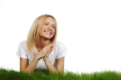 Woman laying on grass Royalty Free Stock Photos