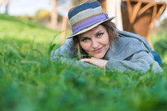 Woman laying on the grass in nature Royalty Free Stock Image