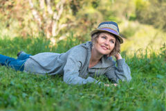 Woman laying on the grass in nature Stock Photography