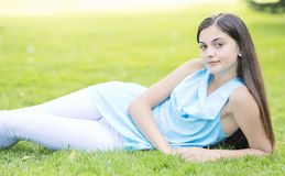 Woman laying on the grass outdoor royalty free stock image