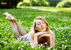 woman laying on  the grass Royalty Free Stock Images