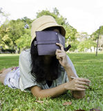 Woman laying on grass and thinking in park Royalty Free Stock Photo