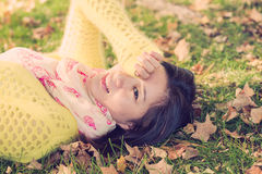 Woman laying in grass Royalty Free Stock Photo