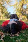Woman laying on grass stock image