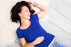 Woman laying on the ground Stock Photos