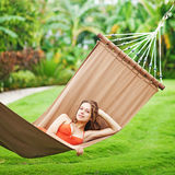 Woman laying in hammok stock images