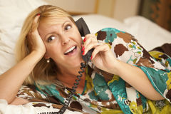 Woman Laying on Her Bed Using the Telephone Royalty Free Stock Photos