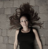 Woman laying with her hair spread out Royalty Free Stock Photography
