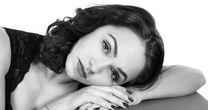 Woman laying on her hand royalty free stock images