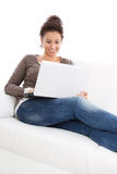 Woman laying with laptop Royalty Free Stock Photography