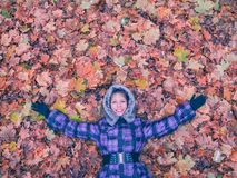 Woman laying in leaves happy. Stock Photos