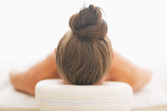 Woman laying on massage table Stock Images