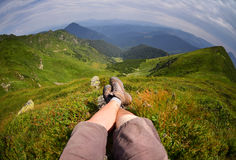 Woman  laying after mountain hiking Stock Photo