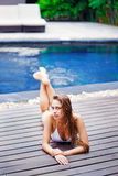Woman laying near a pool Royalty Free Stock Photography