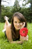 Woman Laying On A Meadow Stock Photo