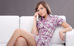 Woman Laying On Couch Talking On Telephone Royalty Free Stock Photo