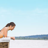 Woman laying on pier Stock Photography