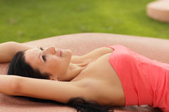 Woman laying in a pink dress Royalty Free Stock Images