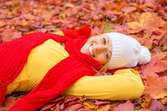 Woman laying in red leafs Stock Photos