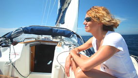 Woman laying and relaxing on sailboat on adriatic sea in croatia. stock video