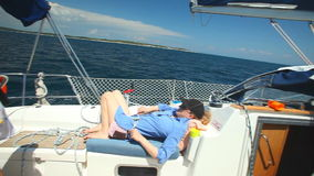 Woman laying and relaxing on sailboat on adriatic sea in croatia. stock footage