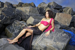 Woman laying on the rocks Royalty Free Stock Photos