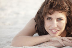 Woman laying on the sand Royalty Free Stock Photography