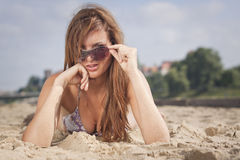 Woman laying on the sand Stock Image
