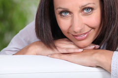 Woman laying on a sofa Royalty Free Stock Photo
