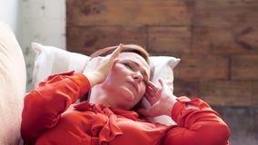 Woman laying on sofa with headache. stock footage