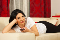Woman laying on sofa and watch tv Royalty Free Stock Photo