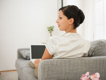 Woman laying on sofa and working on laptop Royalty Free Stock Photo