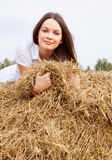 Woman laying on a straw Royalty Free Stock Photo