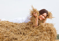 Woman laying on a straw Stock Photo