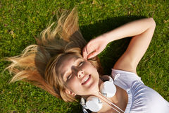 Woman laying in summer in grass Royalty Free Stock Photos