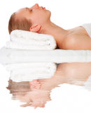 Woman laying on towel royalty free stock photos