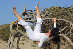 Woman laying on a tree Stock Photography
