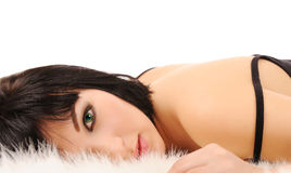 Woman laying in white furs Stock Photo