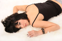 Woman laying in white furs Royalty Free Stock Photos