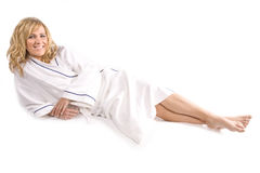 Woman laying in white robe royalty free stock images