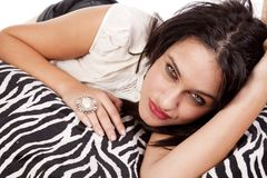 Woman laying on zebra blanket Stock Images