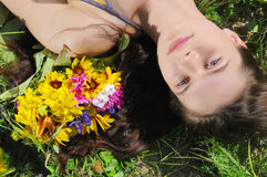 Woman lays in a grass Royalty Free Stock Photography