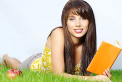 Woman lays on green field Stock Image