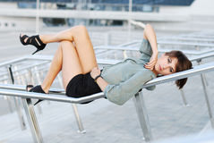 Woman Lays On A Metal Handrail Royalty Free Stock Image