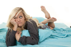 Woman lazy in bed Stock Images