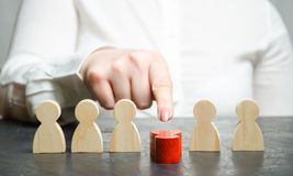 Woman leader dismisses the employee from the team. Female hand pushes a red man. Personnel Management. Bad worker. Demotion. Weak stock photos